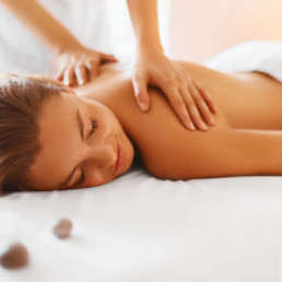 photo of a woman being gien massage therapy